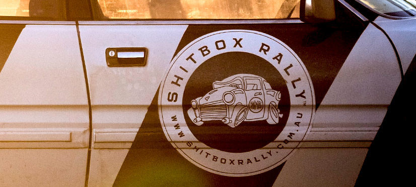 Shitbox Rally logo on a car